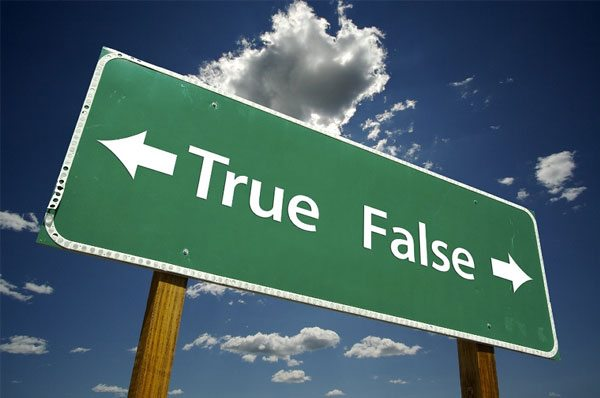 Photo of a sign pointing to true or false.