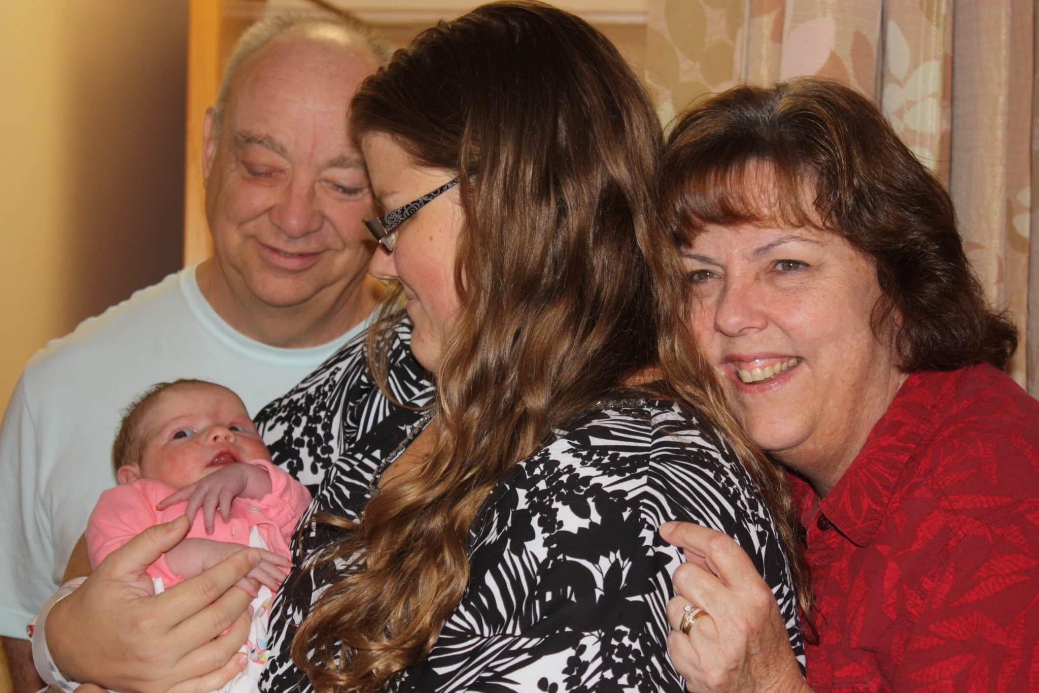 Me (the birth mother) with my daughter and my parents